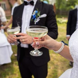 Wedding party, bride and groom with champagne glasses