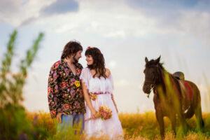 Bespoke Barn Weddings Young couple with horse