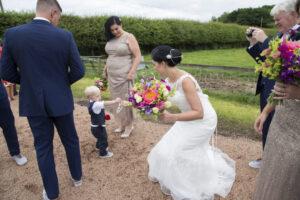 Bespoke Barn Weddings Bride and Paige boy